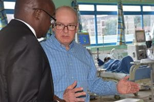 Dean Jay Hess speaks with a colleague in a hospital in Kenya